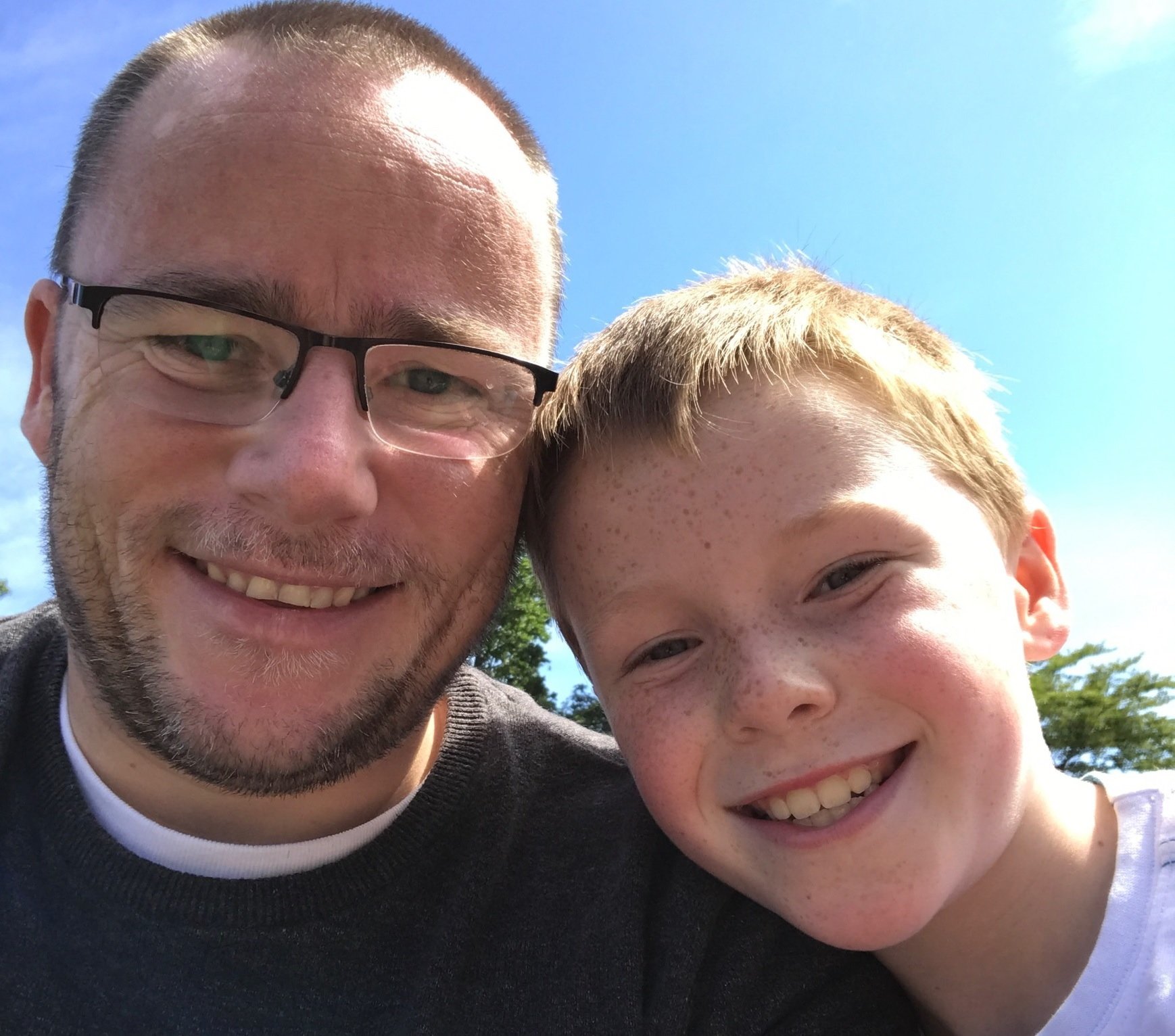 Davie Cowie, left, is taking on a triathlon for son Adam, aged nine.