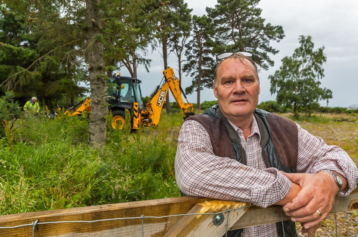 Duncan Brown, owner of Seaview Caravan Park, while the council digger gets to work.