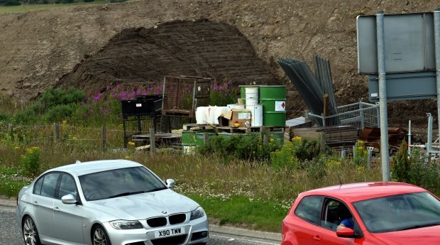 Drums of a flammable chemical used on AWPR work lie next to Dyce Drive in Aberdeen. Photograph: Colin Rennie