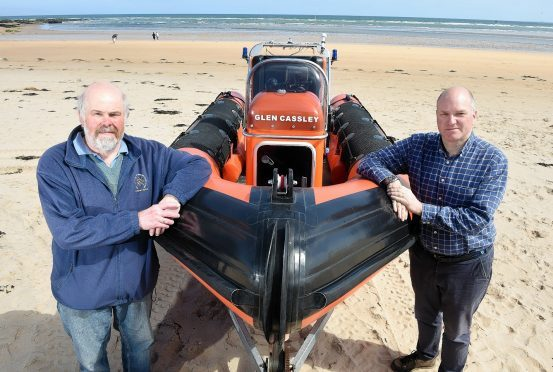 Photographed with their lifeboat on Dornoch Beach are Neil Dalton (left) Chairman of the Association and on the right Antony Hope, a crew member.