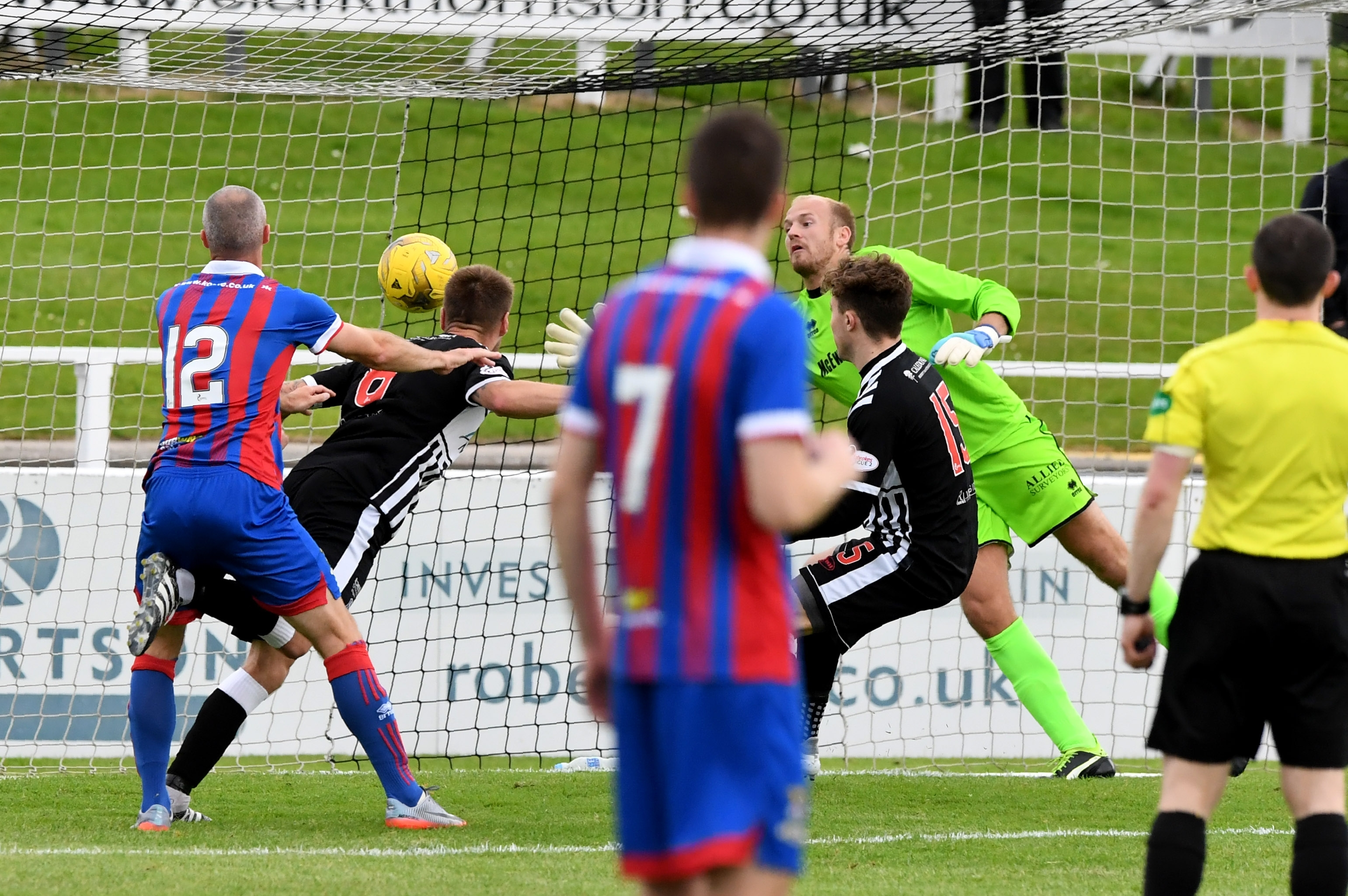 Elgin's Brian Cameron scores to make it 1-0