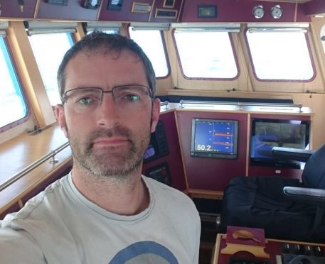 Skipper Terry Jack on board his trawler, Nereus. He is forced to fish miles from his home waters because of the Home Office ruling.