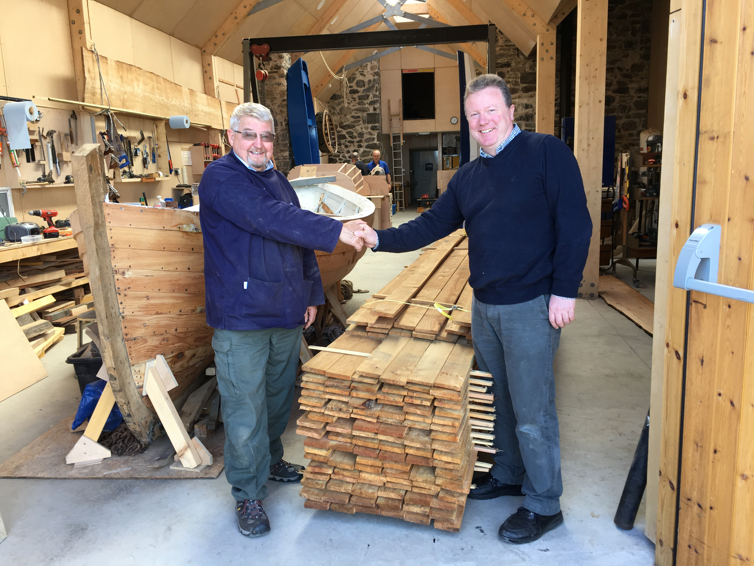 Keith Muir from Portsoy Boat Shed (left) and Michael Bruce (Glen Tanar) who donated the timber