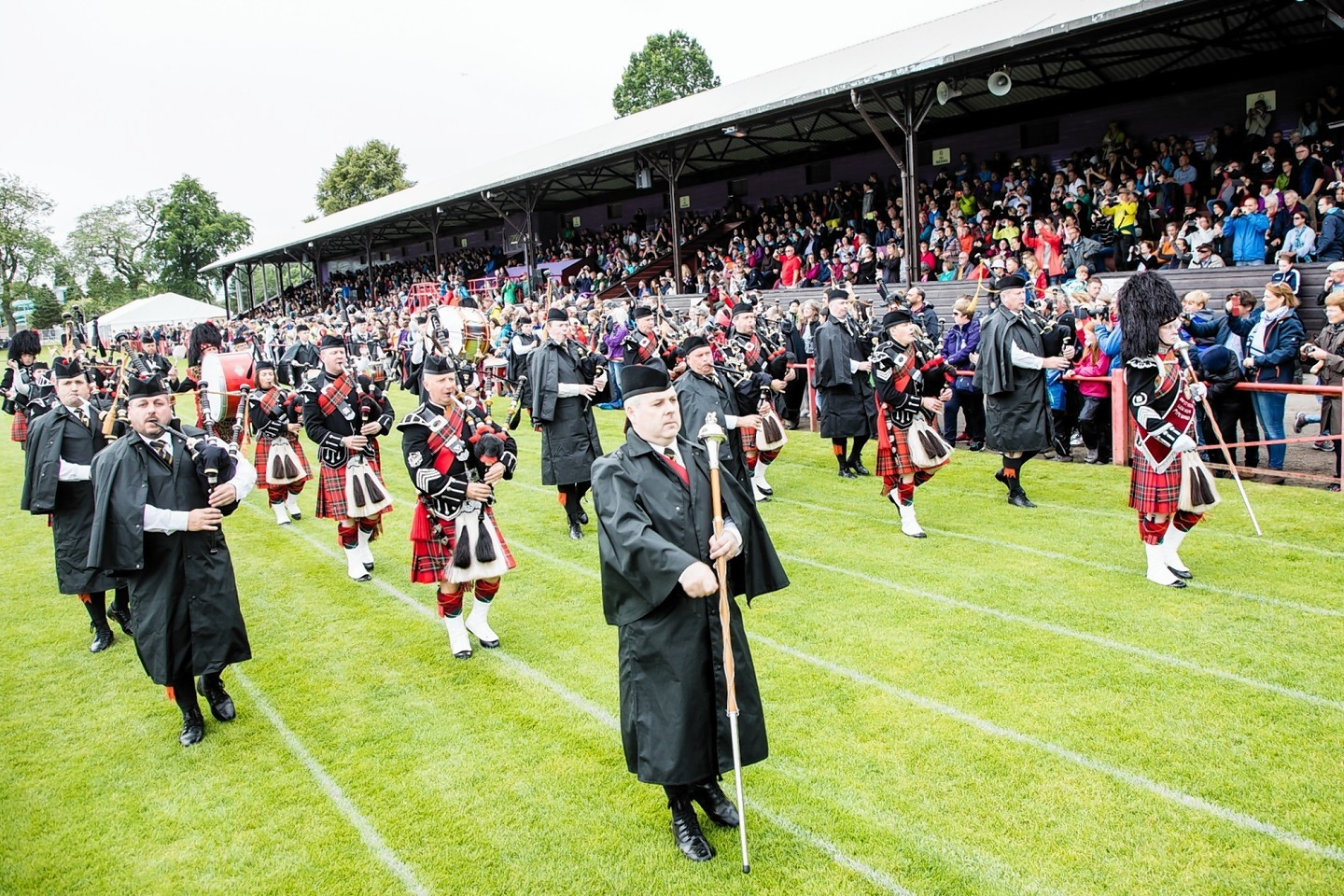 The Inverness Pipe Band delight the crowd at the Inverness Highland Games.