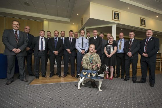 Description: Sgt Dee the dog is introduced to the WOs and SNCOs Mess at RAF Lossiemouth on promotion. Dee is the Station mascot Originator: FS Young Section: Police Ext:  *For more information contact Photographic Section, RAF Lossiemouth, IV31 6SD. Tel: 01343 817191