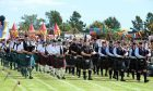 The massed pipe band perform at the Stonehaven Highland Games.