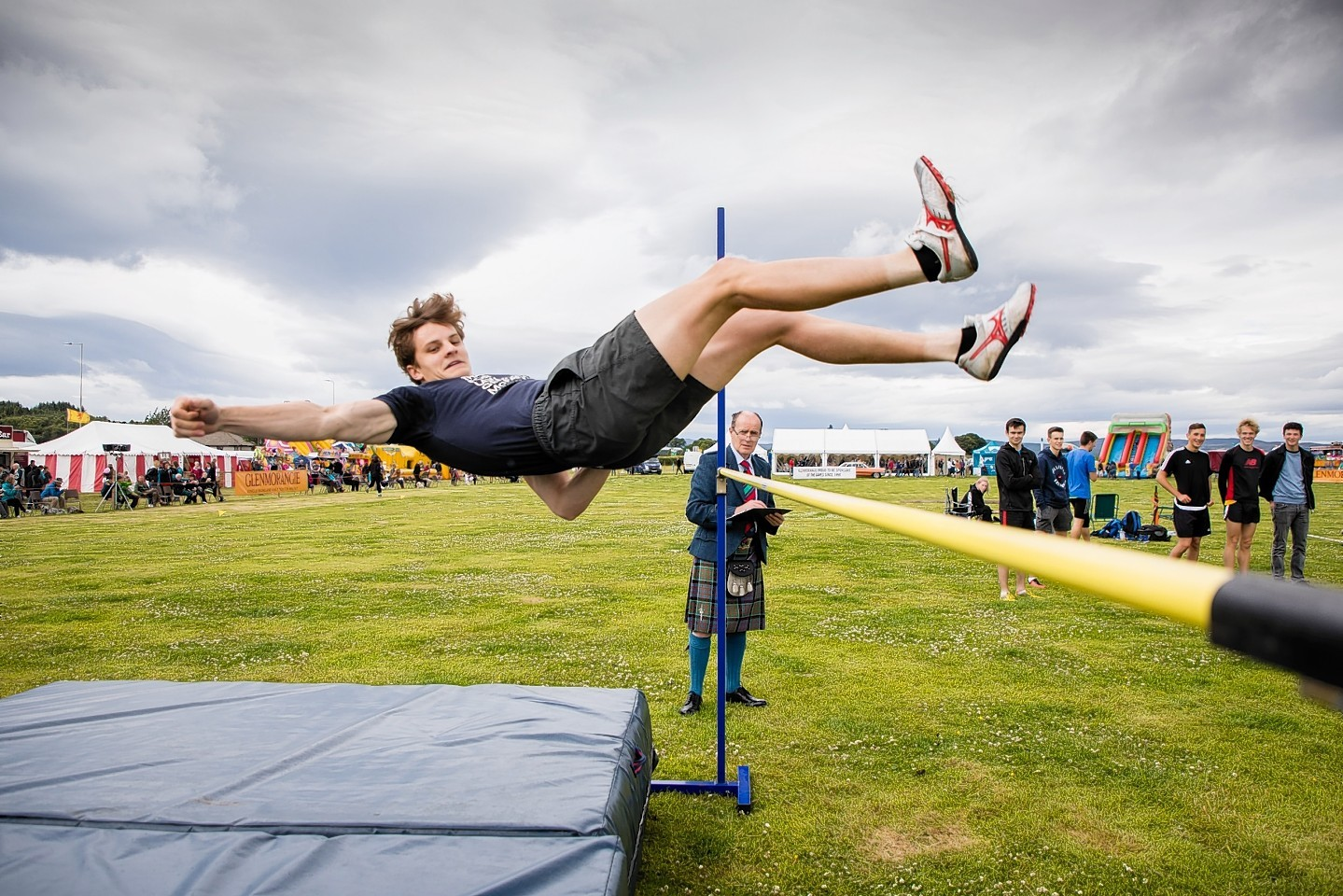 A competitor clears the bar in the high jump at the Tain Highland Gathering.