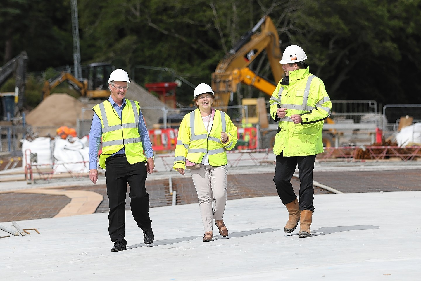 31 July 2017: Councillors Allan Henderson, left, and Trish Robertson were given a tour of the West Link bridge and the new Highland Rugby Club building by Highland Council's head of infrastructure Colin Howell, right. Picture: Andrew Smith