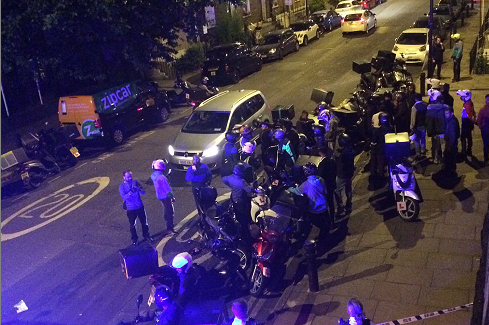 Police at the scene of one of last week's acid attacks in London