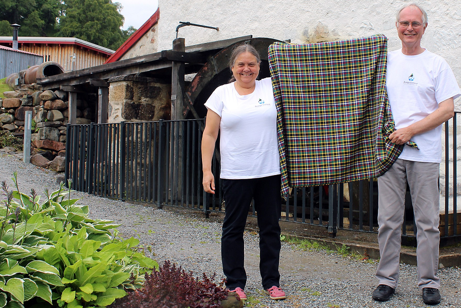 John and Christine Carney, of the charity Busega Scotland, with the special Knockando shuka