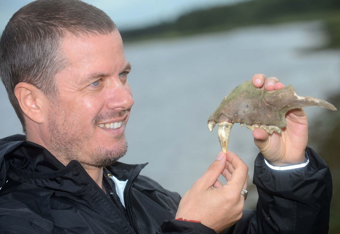 Mal Burkenshaw sizes up the jaw bone he found in the River Lossie.
