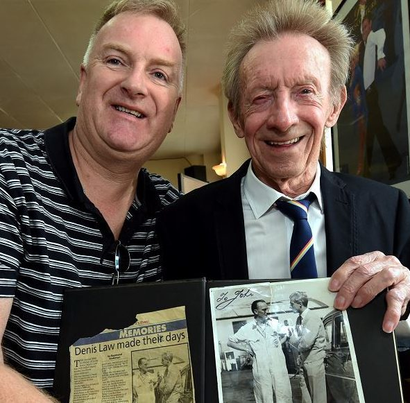 Kevin Sherwin with Denis Law and the signed picture of his father meeting the legendary footballer. (Picture: Jim Irvine)