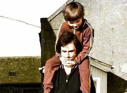 Jim Spaine Snr lifts the Dinnie Steens with son Jim jnr on his back in 1975 at the Potarch Hotel.