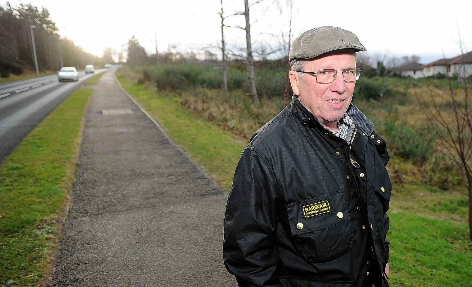 Picture by SANDY McCOOK    28th December '16 Smithton and Culloden Community Council Chairman at the site of the proposed housing development on Tower Road where they have concerns over access.