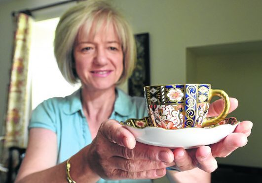 Property manager and head gardener, Susan Burgess with some crockery.