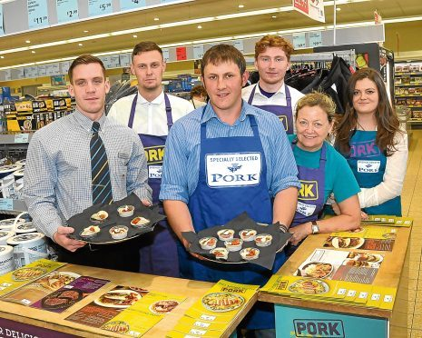 Russell Rennie, centre, in Aldi's Inverurie store with manager Jamie Lucas and the Specially Selected Pork ambassadors.