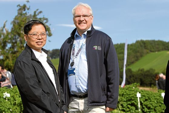 Jonathan Snape - Head of James Hutton Ltd - with Dr Hu from China.
