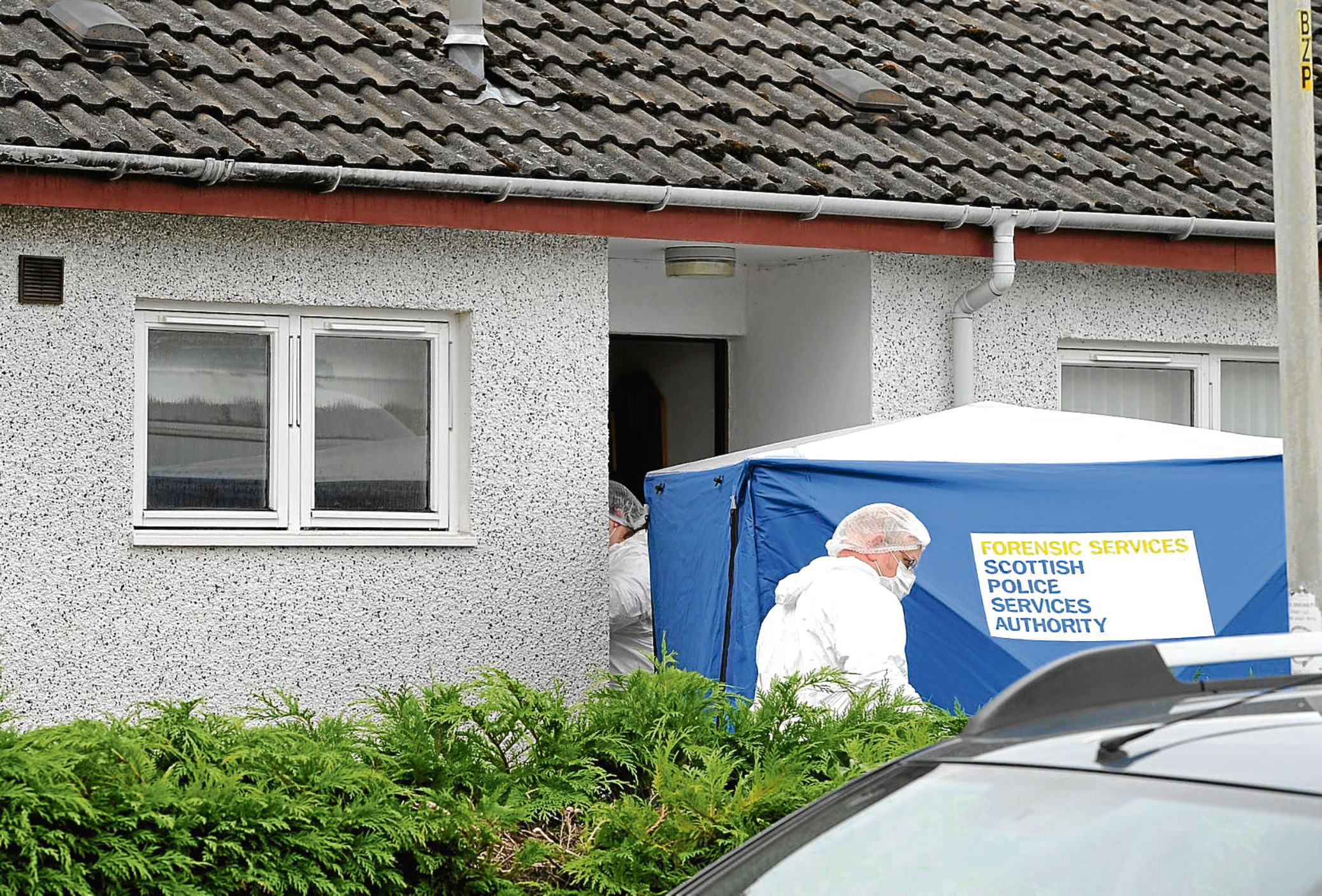 Police and their forensic officers at the scene last night of the 'unexplained death' of Murdo Mackinnon in Kintail Crescent, Inverness. Pic by Sandy McCook.