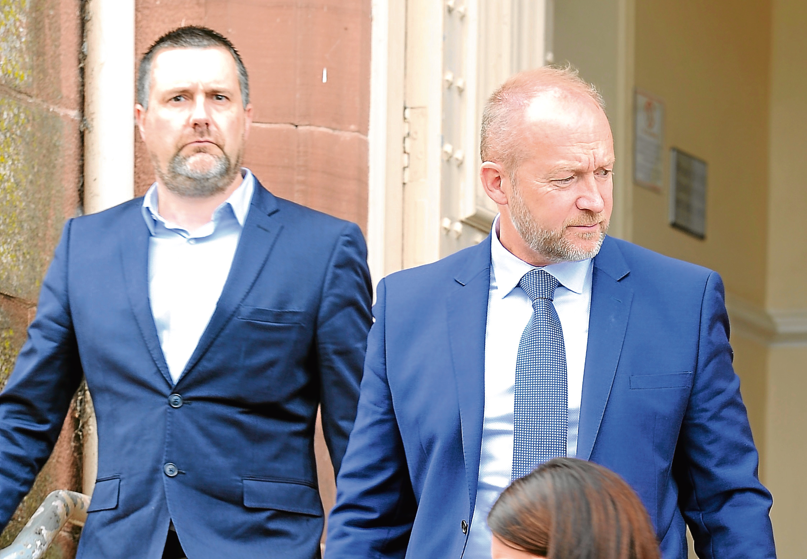 Steve Cardno and Mark Syme (right) of Whytes Crane Hire leave Inverness Sheriff Court