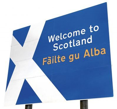 A sign on the border crossing to Scotland from England.
