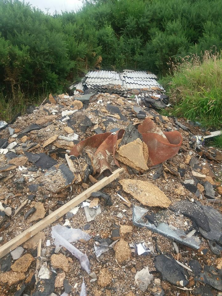 Sheets of asbestos have been dumped near Tynet Road at Spey Bay.