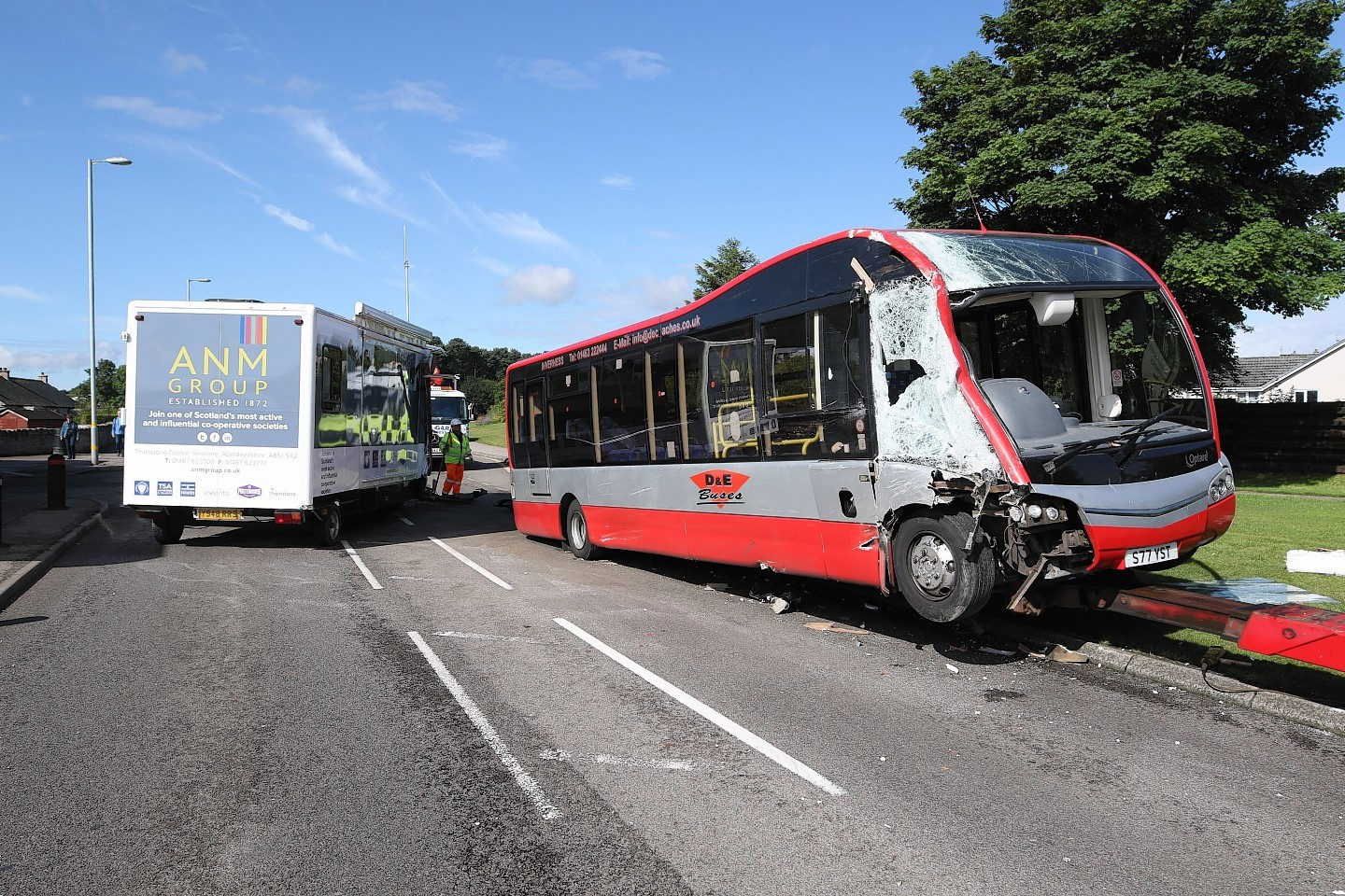 2 August 2017: Scene of an RTC involving a bus and an exhibition trailer on the A96 at the Gulf petrol station in Nairn. It is understood that the trailer was being towed west to the Black Isle Show when it became detached from the lorry that was towing it, and collided with a bus heading east. The lorry that had been towing the trailer was taken away from the scene, where it was inspected by police and representatives from the Driver & Vehicle Standards Agency. A towing hitch could be seen on the grass verge close to the scene of the collision. The road was closed in both directions with diversions in place, with some local traffic allowed to pass the scene via the petrol station forecourt. Picture: Andrew Smith