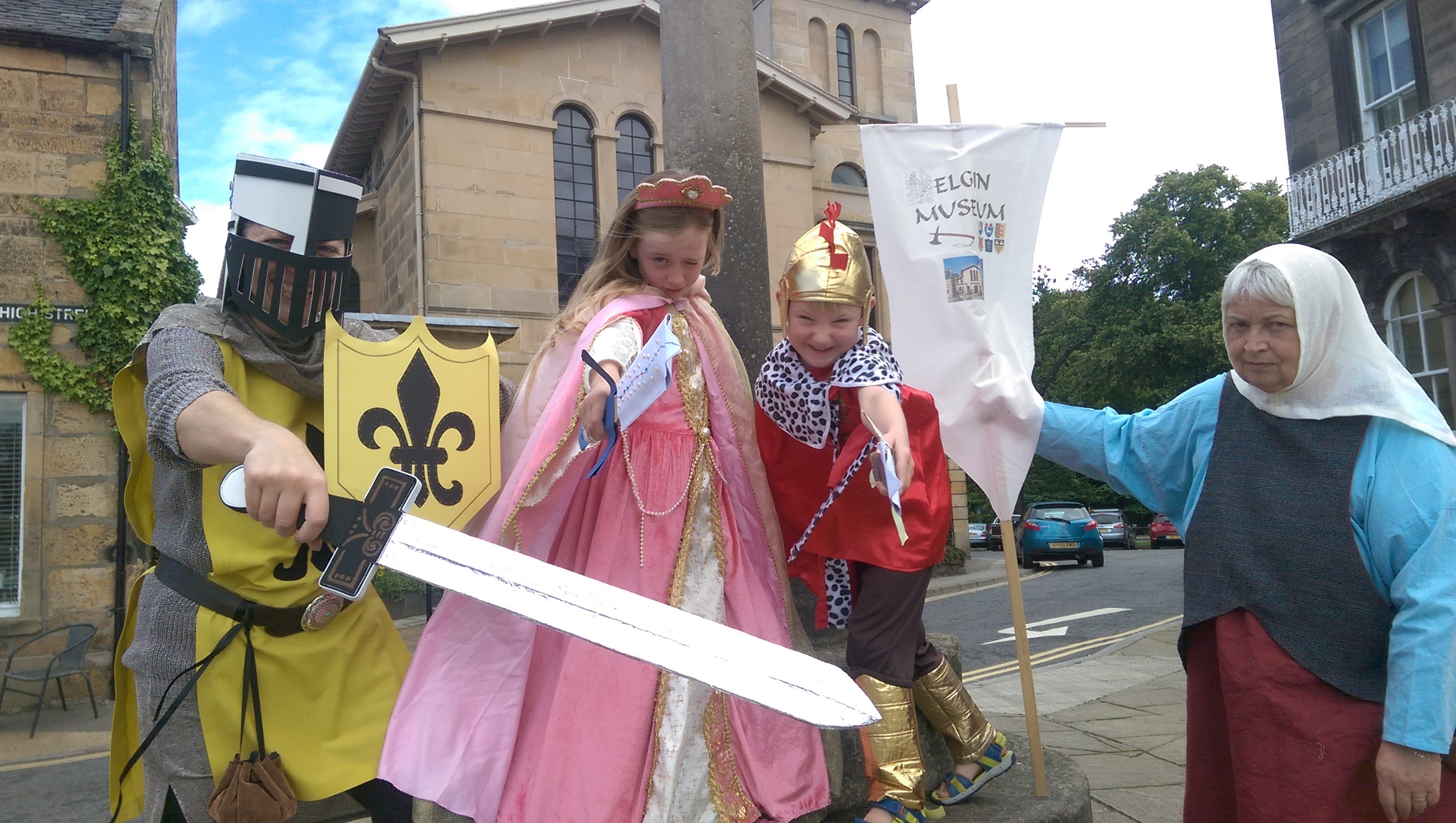 Museum volunteer Claire Herbert, West End pupils Fiona and Donald Coull and volunteer Mary Shand joined the assault on the castle.