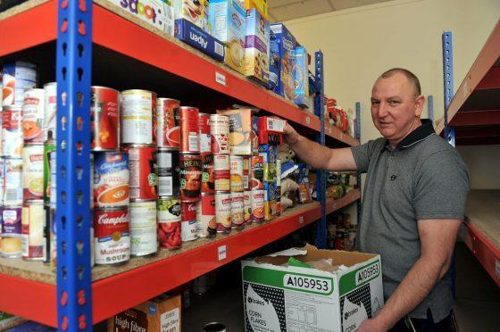 Gilbert Grieve helps put food handouts together for Moray Foodbank.