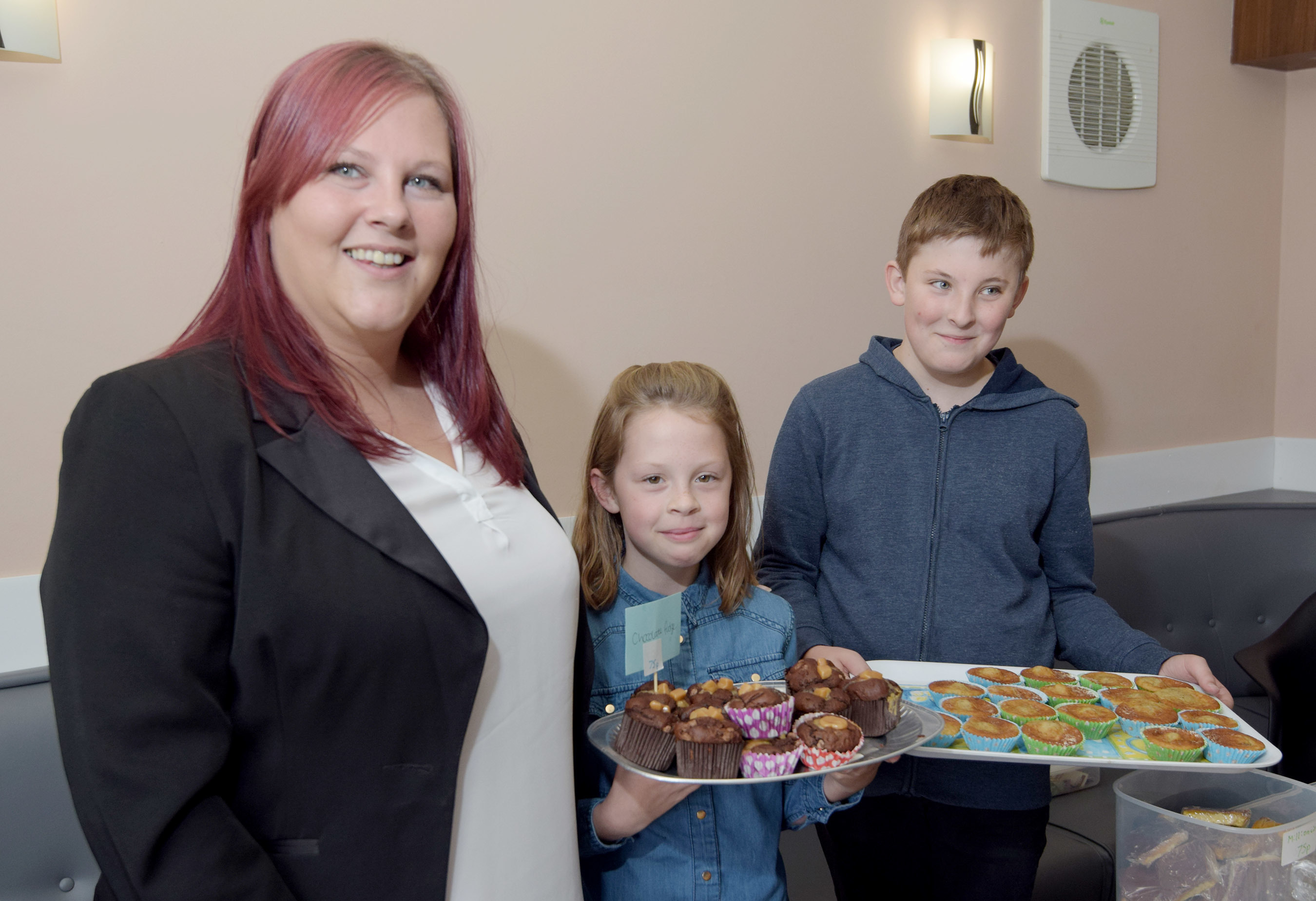 Gary Campbell's partner, Leanne Crawford,  with helpers Lauryn MacKenna (9) and Kye Crawford (12) at the home baking stall at Sunday's fun day. PICTURE IAIN FERGUSON, THE WRITE IMAGE