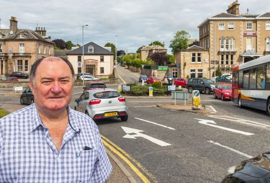 Elgin City South councillor John Divers believes too much traffic uses the Laichmoray roundabout.