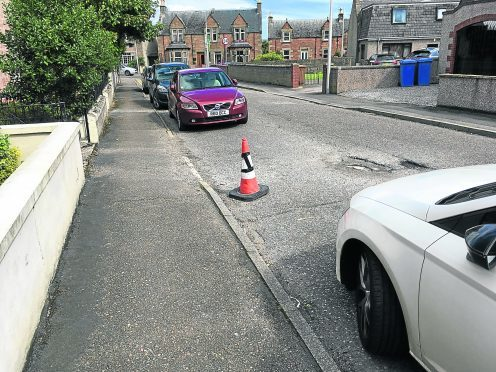 Traffic cones put on an Inverness street by residents to stop others parking there