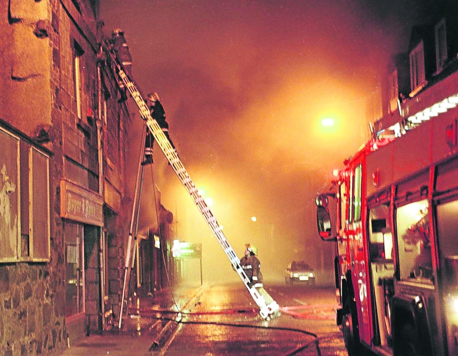 Firefighters tackle the fatal fire in High Street, Fraserburgh, in 1998