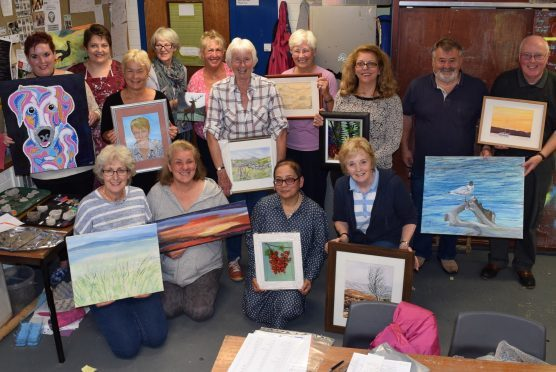 Members of the Garioch Art Group show some of their work ahead of this weekend's exhibition opening.