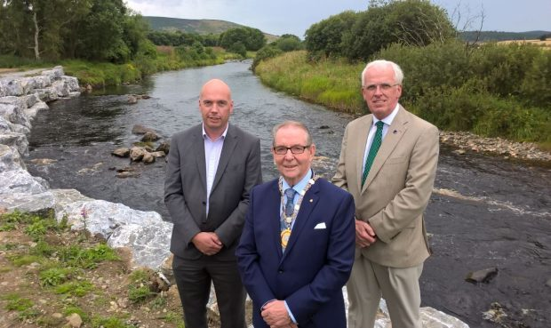 Aberdeenshire Council Project Manager, Gavin Penman; Deputy Provost Ron McKail; and Leader of the Council, Jim Gifford at the formal opening of Huntly's Flood Protection Scheme.