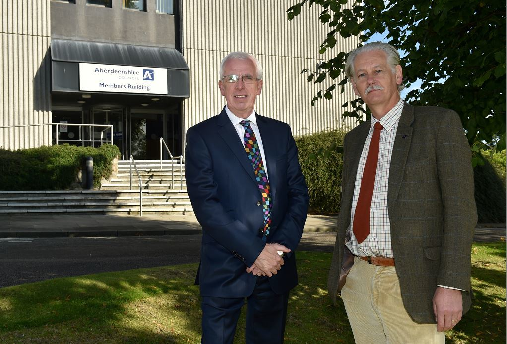 The administration has said free parking periods  are unsustainable - Pictured are Jim Gifford and Peter Argyle (Picture: Colin Rennie)