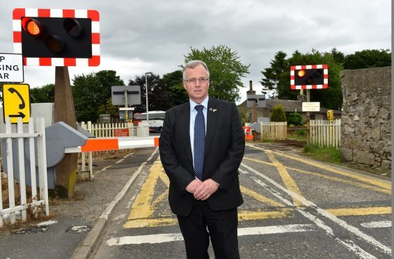 Fergus Hood at the problem level crossing in Kintore. (Picture: Kenny Elrick)
