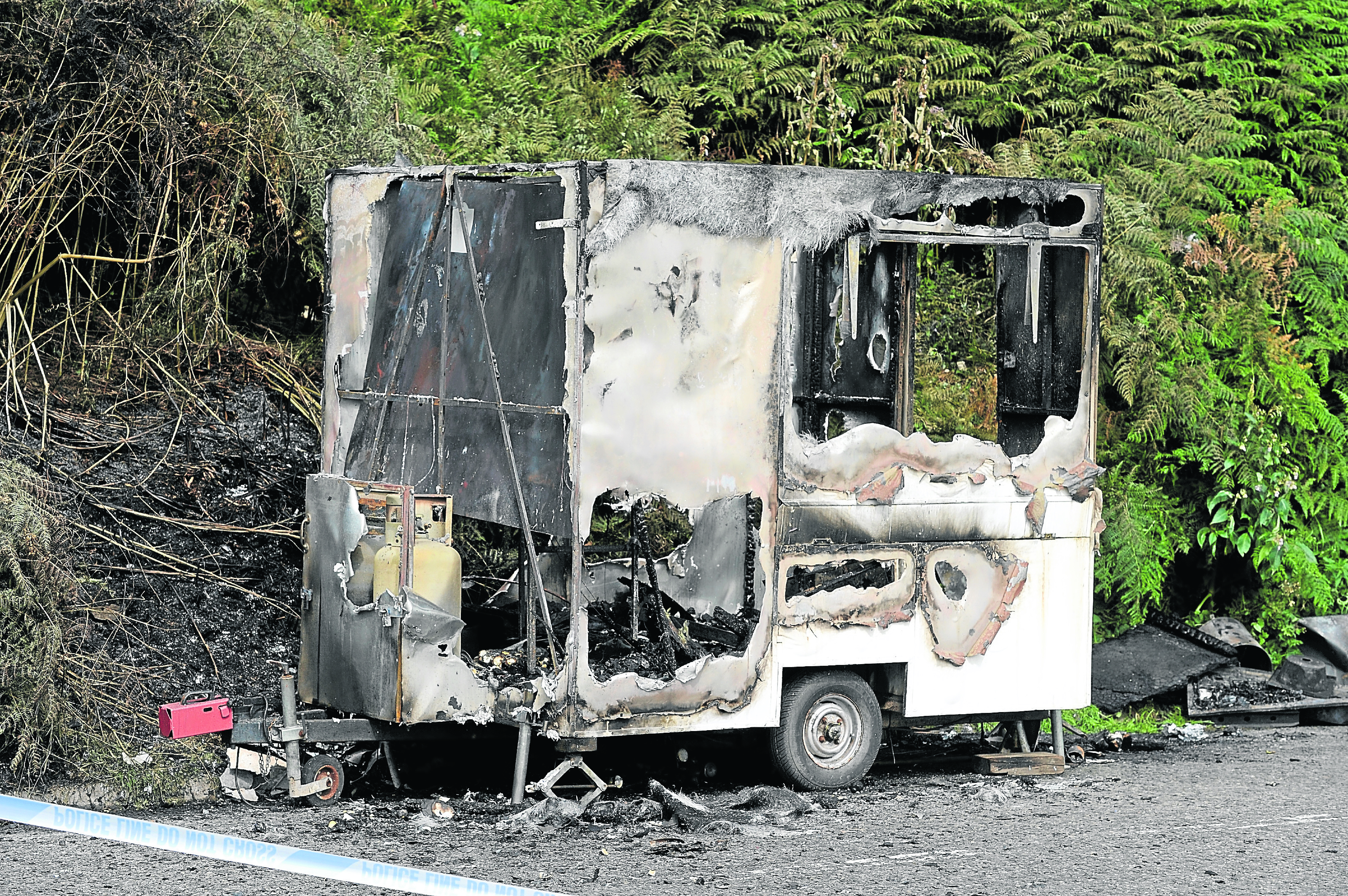 The burnt out snack caravan beside the A9 north of the Cromarty Bridge which was destroyed in an early morning fire yesterday. Pic by Sandy McCook