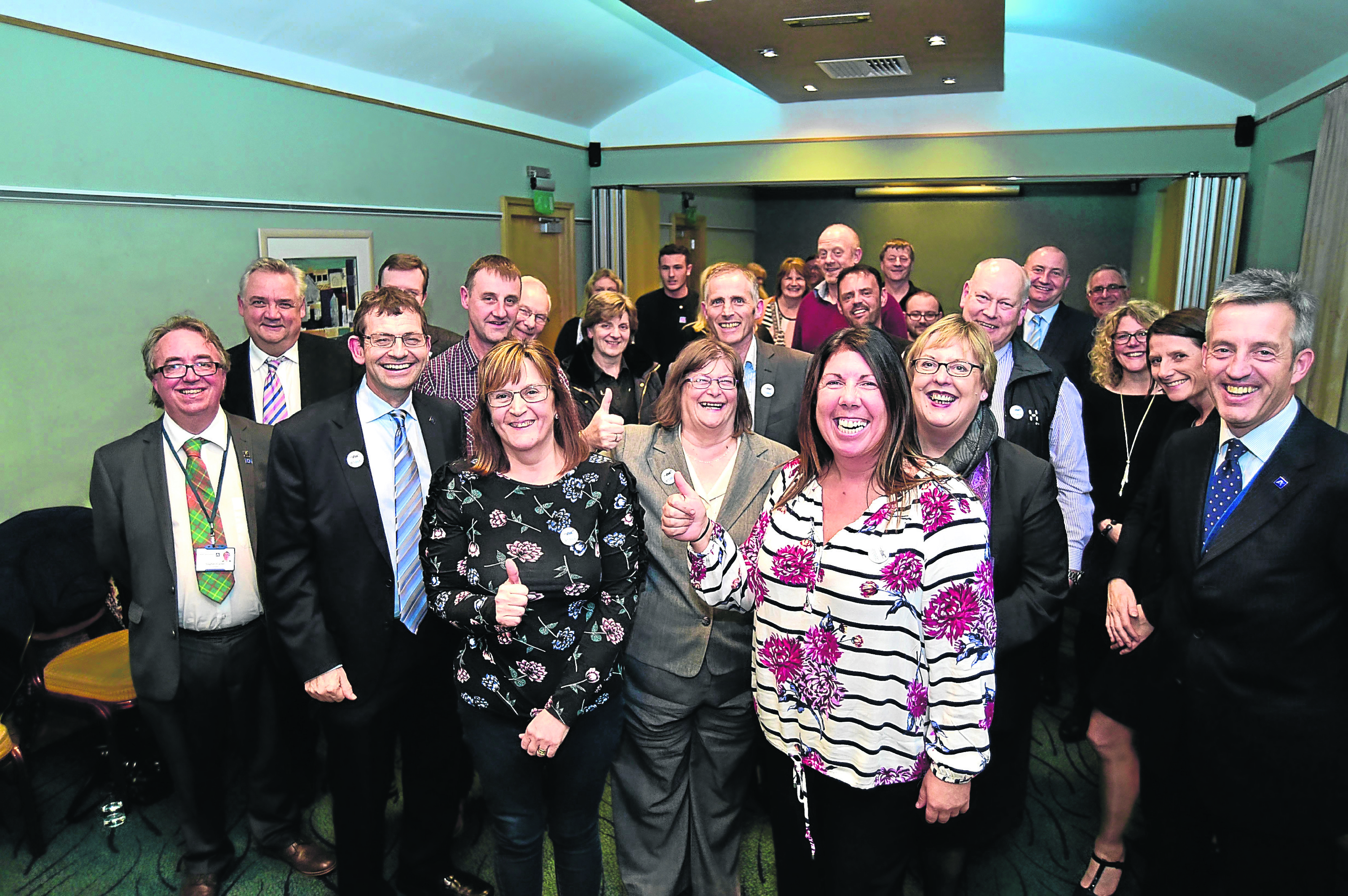 Happy Peterhead business owners after the vote was returned in favour of the Bid