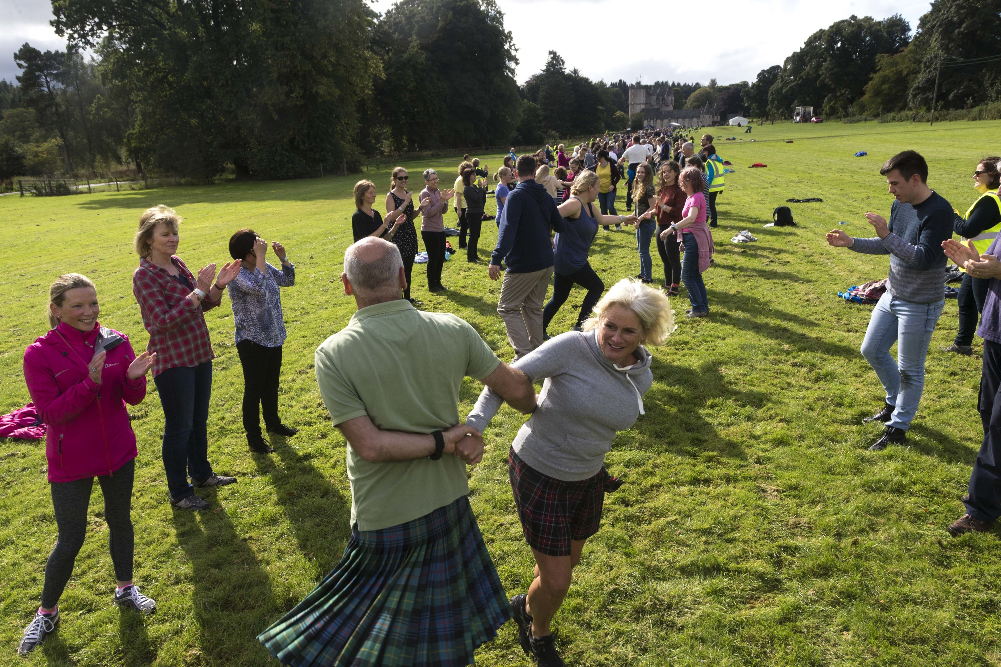 People taking part in the world record for the longest Strip the Willow at the National Trust for Scotland property Castle Fraser in Aberdeenshire
