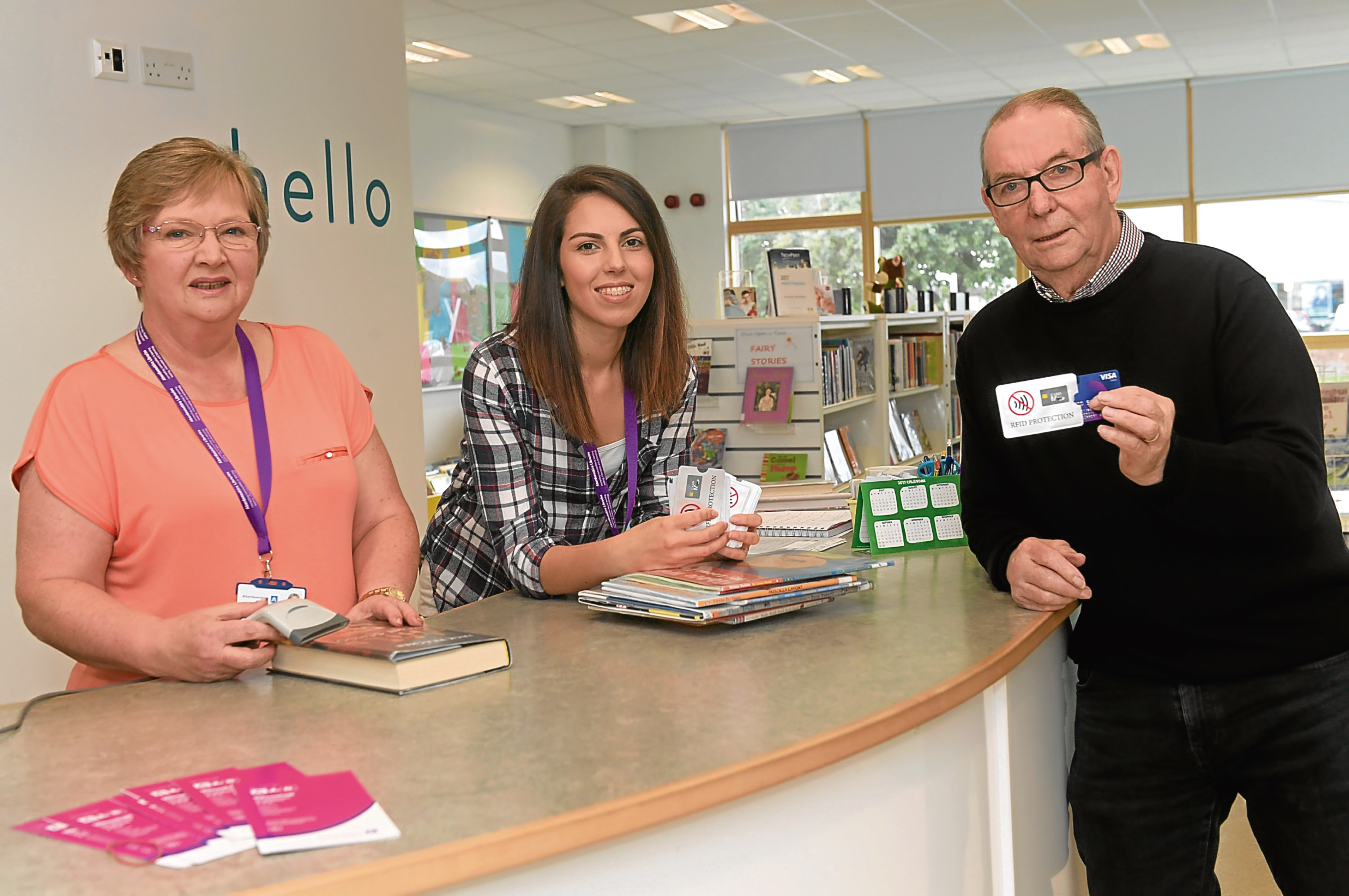 Councillor Ron McKail is pictured with, from left, library staff Liz Brownlee and Janet Mowat.