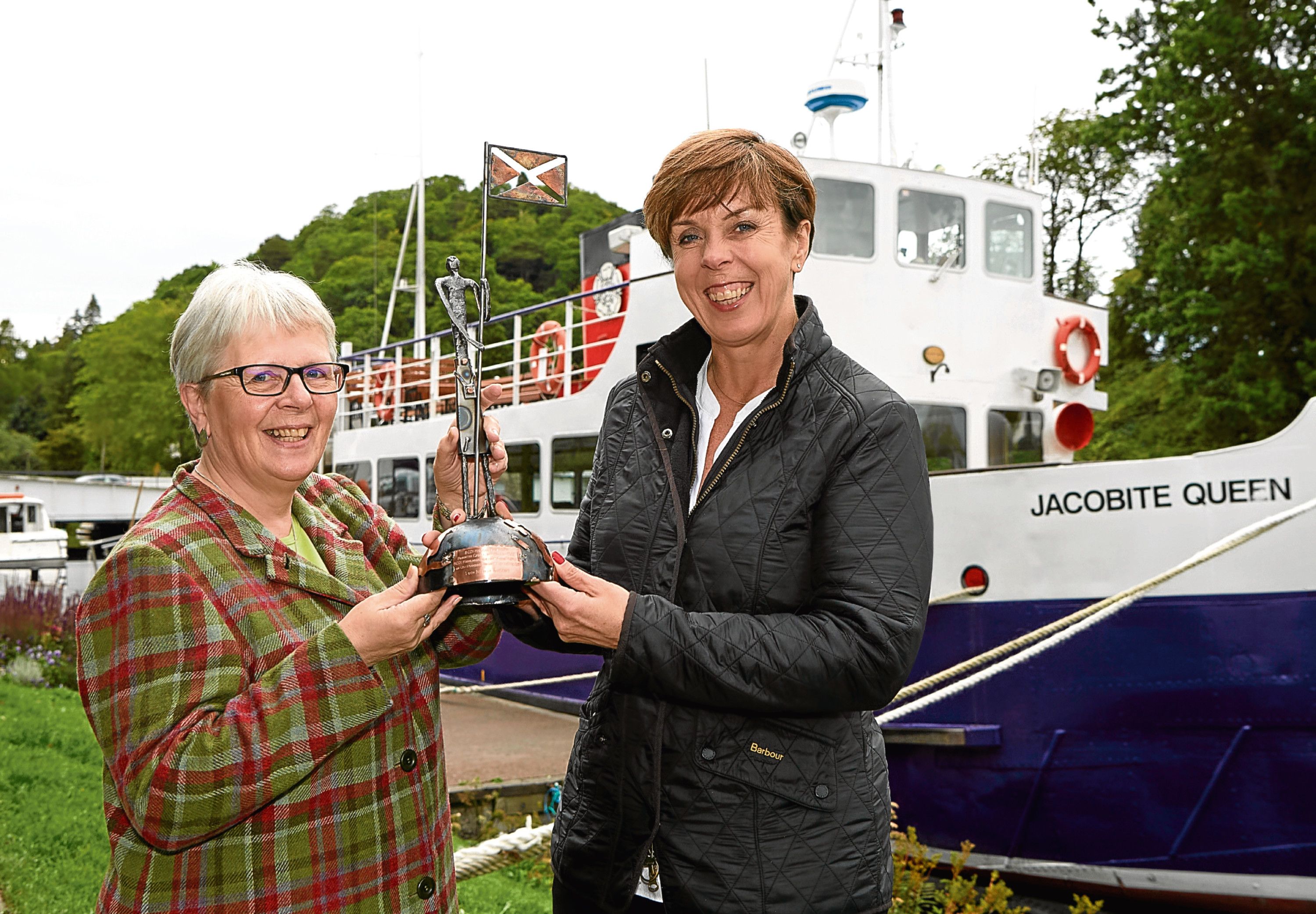 Freda Newton of Loch Ness by Jacobite receives the SCDI Highlands and Islands Chairs Award for Outstanding Business Achievement from Jane Cumming.