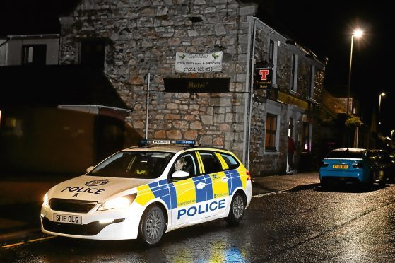Police Scotland at the scene an incident outside Commercial Hotel, Insch. Picture by Kenny Elrick.