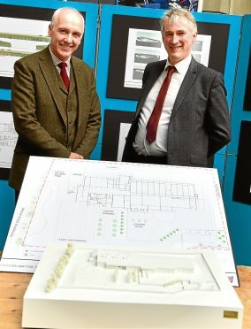 Uel Morton and David Nimmo with plans at the public exhibition