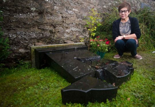 The gravestone remembering Aida Stewart's husband, Joseph, has been broken into pieces.