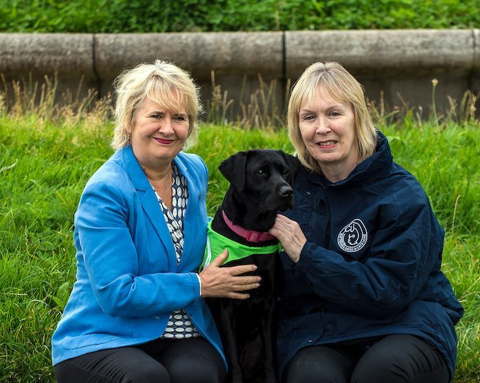 Cabinet Secretary for Environment, Climate Change and Land Reform, Roseanna Cunningham MSP, outside Holyrood today, Dee McIntosh, Battersea Dogs & Cats Home Director of Communications with Holly, a 4 year old black Labrador.