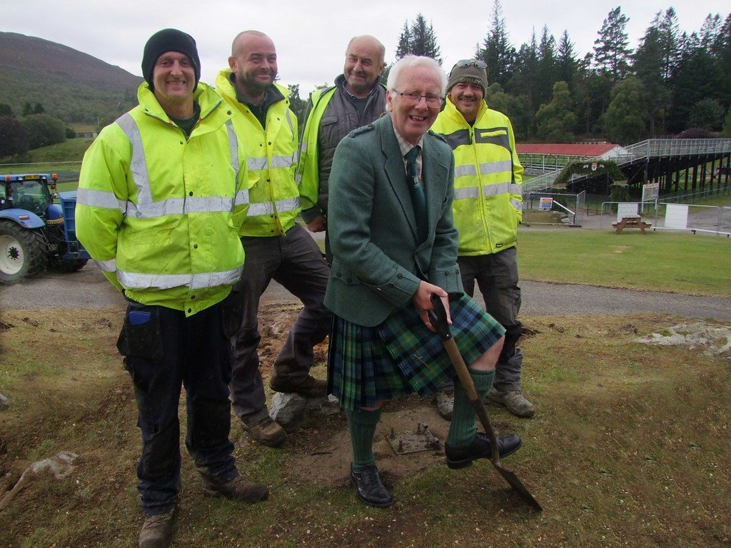 President of Braemar Royal Highland Society David Geddes, helped staff from building contractor Gordon Mitchell's start with the ground clearing in the Games Park
