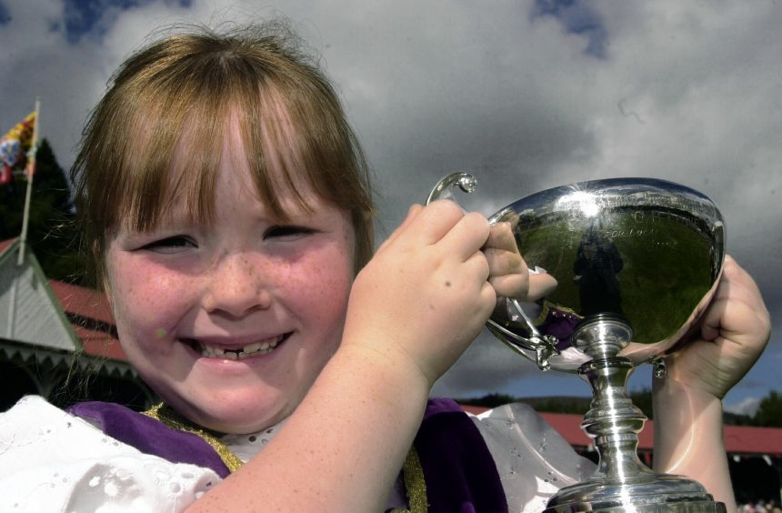 Iona Fyfe, from Balmoral Estate, with her trophy for the best local dancer u9 in 2003.