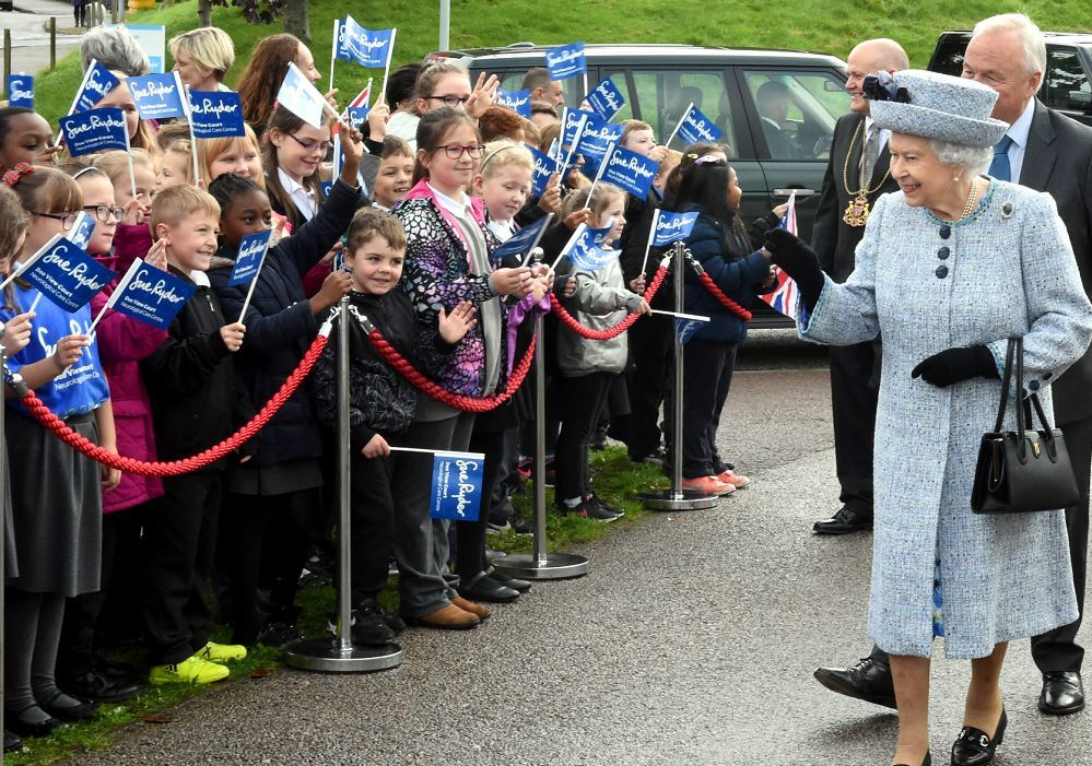 The Queen meets youngsters from Abbotswell primary school  outside Sue Ryder, Dee View Court in Kincorth. Pic by Jim Irvine.