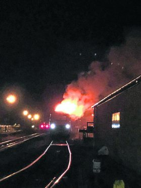 A train on fire between Exeter St Davids and Tiverton Parkway stations.  Pic courtesy of Devon Live