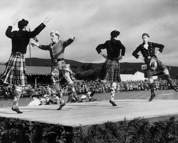 Dancers Billy Forsyth, Bridge of Allan, Harry Picken, Newcastle, Michael McKay, Aberdeen and Sandy McNidder, Paisley, dance the Highland Reel in 1964